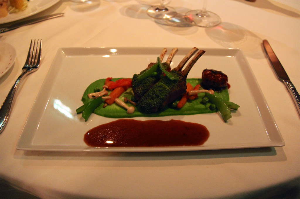 Greg's Herb Crusted Lamb Rack - Pea Purée, Tomato Confit, Baby Carrots, Spice Meatball, Garlic Jus