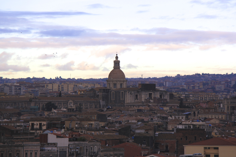 The sun rises over Catania, Sicily